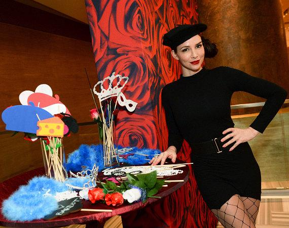 A model poses in the photo booth at BARDOT's grand opening