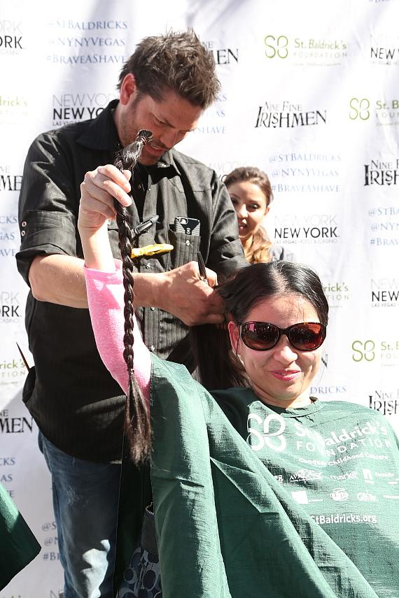 A woman cuts her hair for the first time in 10 years to donate at New York-New York's 6th annual St. Baldrick's Day