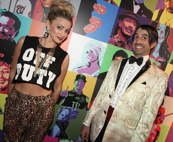 Angel Porrino and Gazillionaire Pose with Rockhouse Celebrity Wall