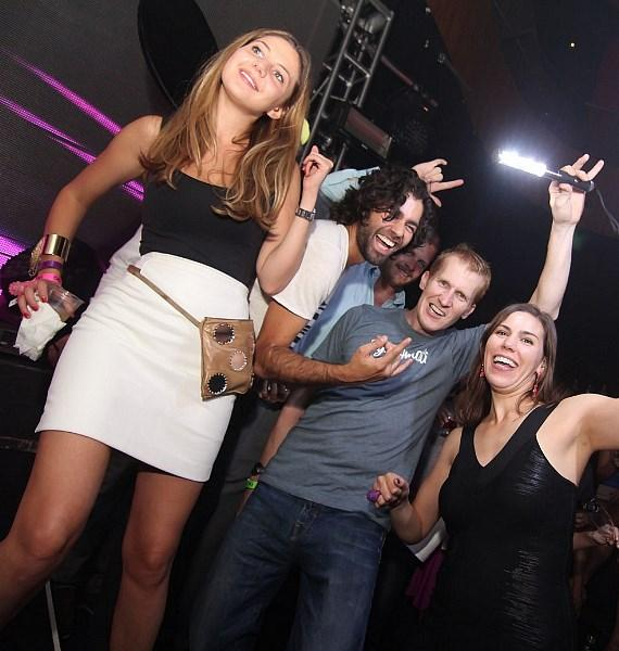 Adrian Grenier with friends at Rain Nightclub