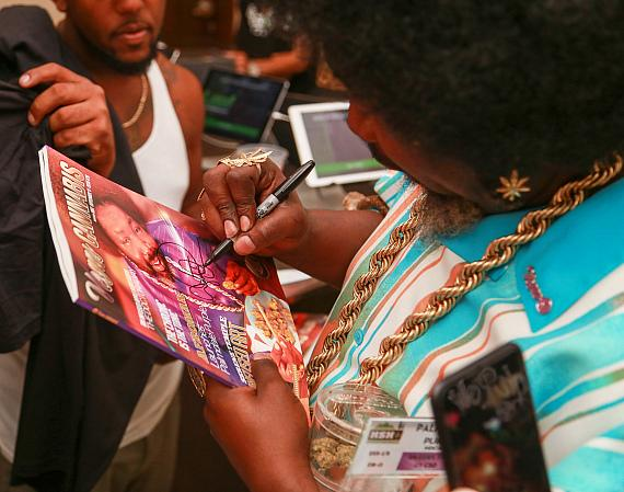 Afroman signs autographs for fans at NuLeaf Las Vegas