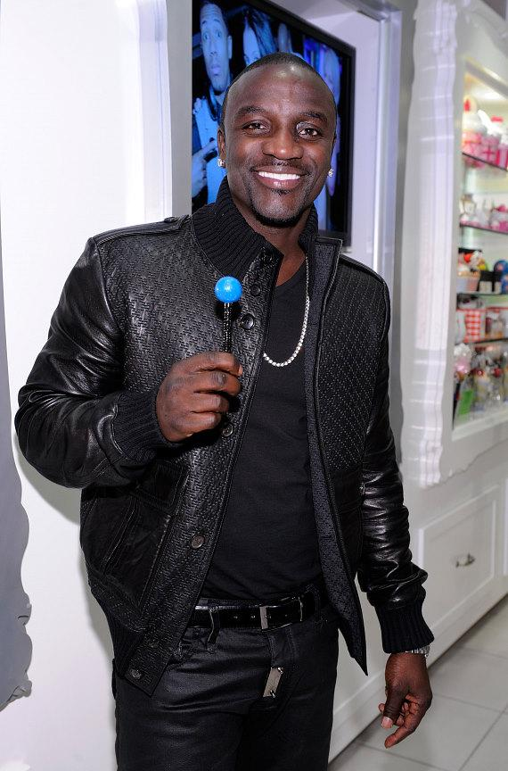 Akon filling a bag of candy at Sugar Factory inside Paris Las Vegas