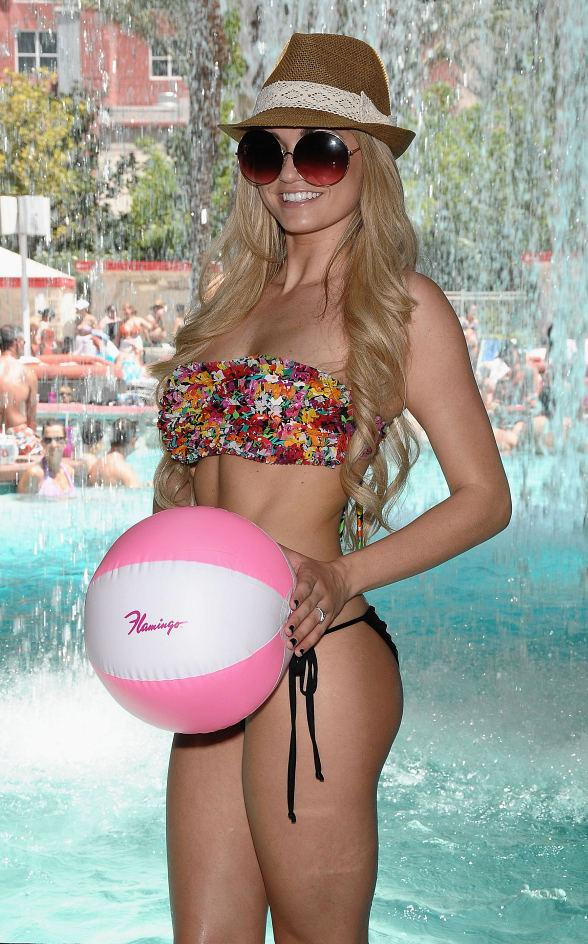 Angel Porrino poses behind the waterfall at GO Pool