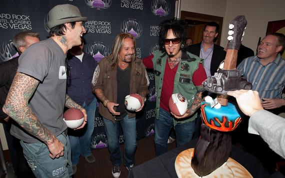 The band was presented with specially designed Mötley Crüe footballs in celebration of their sold out opening shows during Super Bowl Weekend.