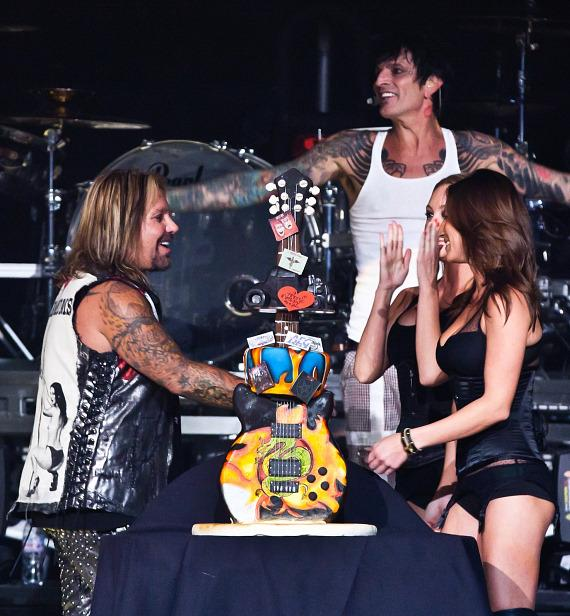 Vince Neil is presented with a birthday cake at The Joint
