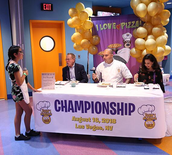 Autumn presents her original dish to judges (left to right) John Parlet, Chef Joe Youkhan and Maria Silva