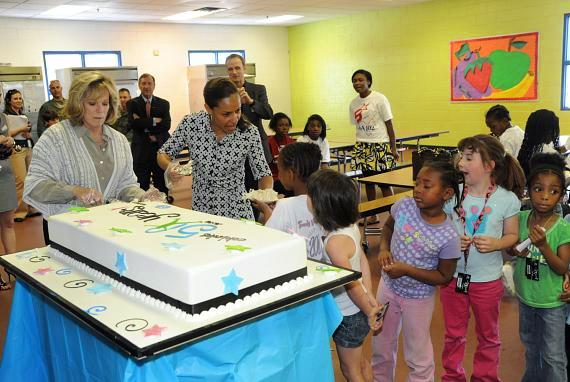 B&GCLV board members MaryKaye Cashman and Joselyn Cousins cut the Freed's Bakery 50th birthday cake for the club members to enjoy