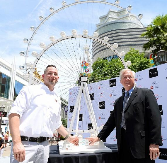 Adam Reed Tucker and High Roller General Manager Eric Eberhart pose with the replica of the High Roller made completely from LEGO bricks