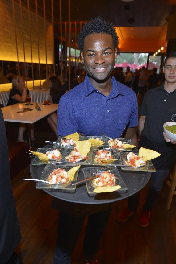 A Mercadito server delivers one of Mercadito's signature ceviche dishes