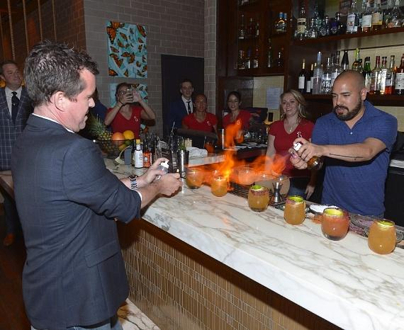 "Paul Tanguay and Paul Sauter from The Tippling Bros. light the bar on fire with the signature drink ""Big Nose Goes to Mexico"""