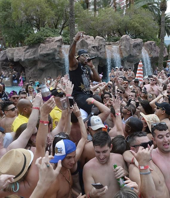 Flo Rida crowd surfs at The Flamingo GO Pool in Las Vegas