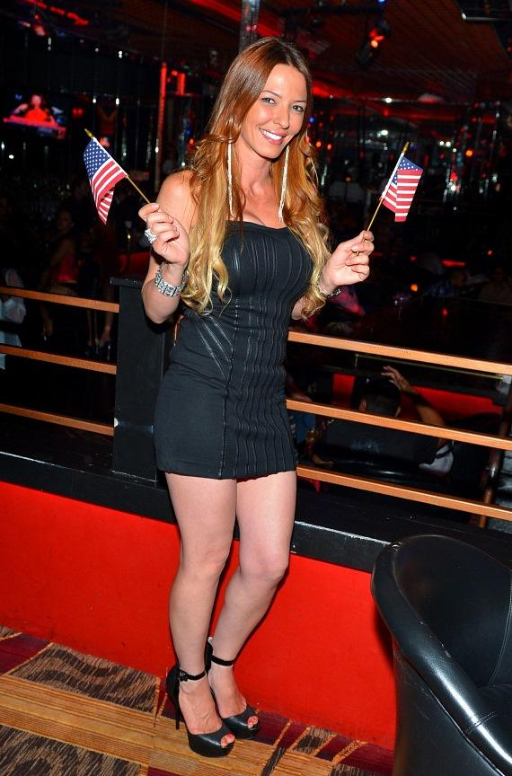 Drita D'Avanzo strikes a pose with American Flags at Crazy Horse III