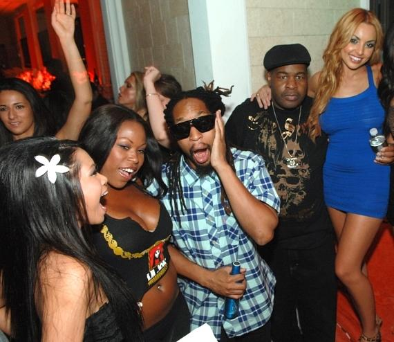 Lil Jon surrounded by lovely ladies