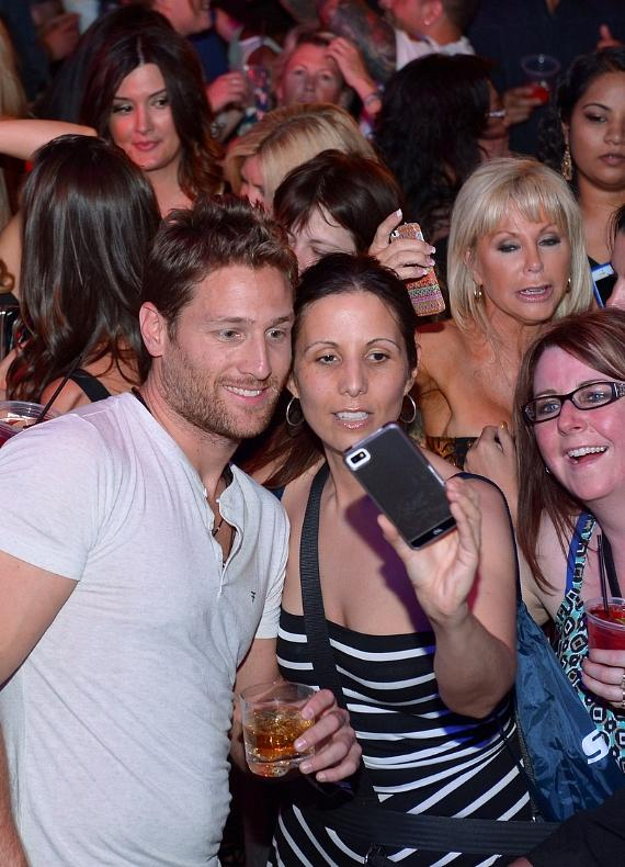 Juan Pablo Galavis takes selfies with fans at Chateau Nightclub and Rooftop