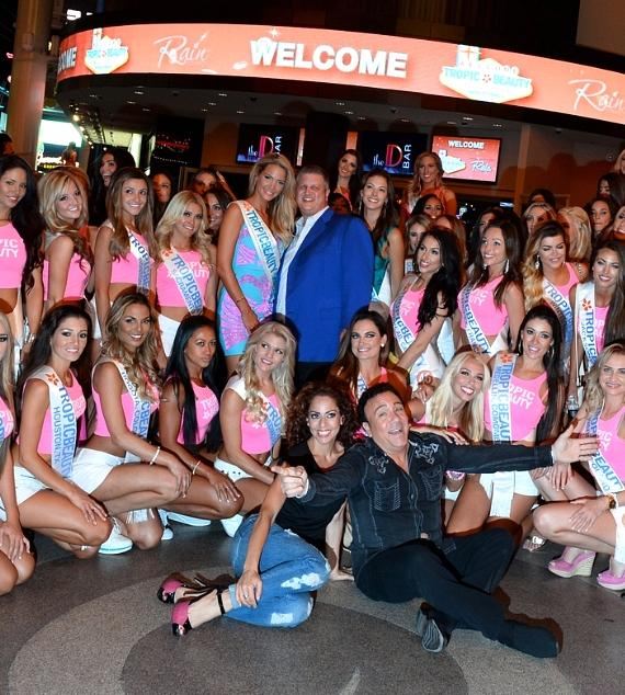 Miss TropicBeauty 2013 Linda Zimany and The D Las Vegas Owner Derek Stevens and the TropicBeauty 2014 contestants and Frankie Scinta (sitting R)