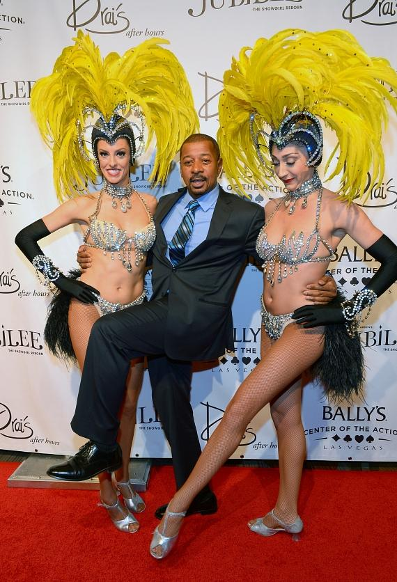 Showgirl Brittany Guinane, director Robert Townsend and showgirl Taryn Olivieri arrive at the 'Jubilee!' show's grand reopening at Ballys Las Vegas