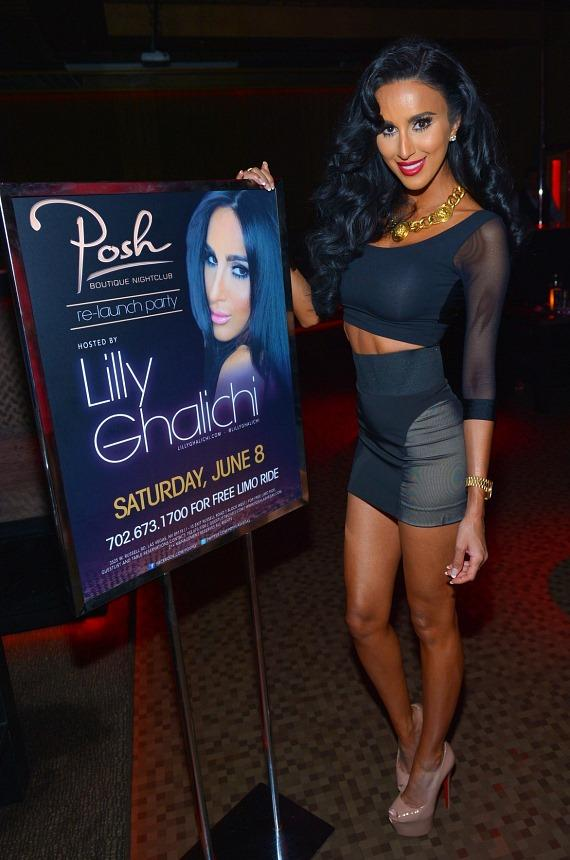 Lilly Ghalichi with her poster at Posh Boutique Nightclub