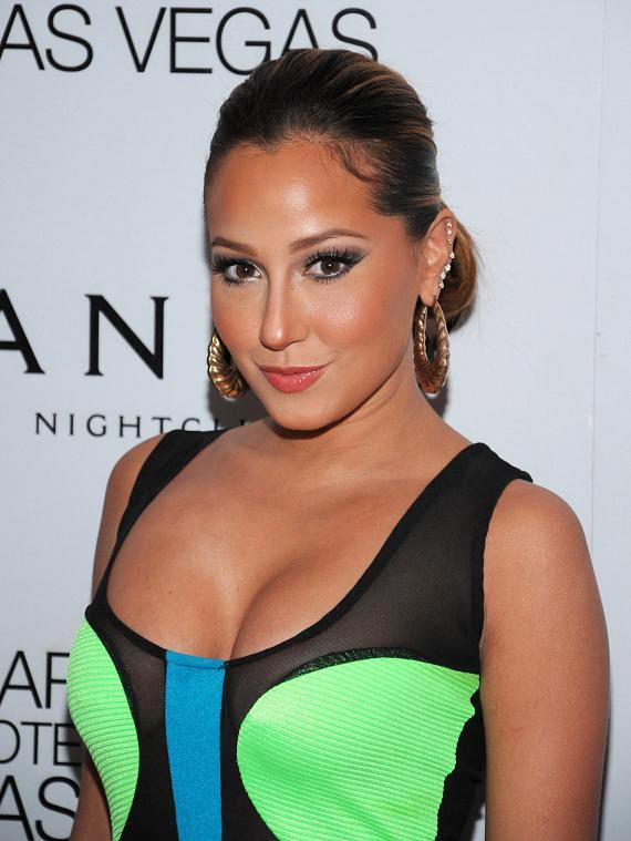 Adrienne Bailon on red carpet at Vanity Nightclub