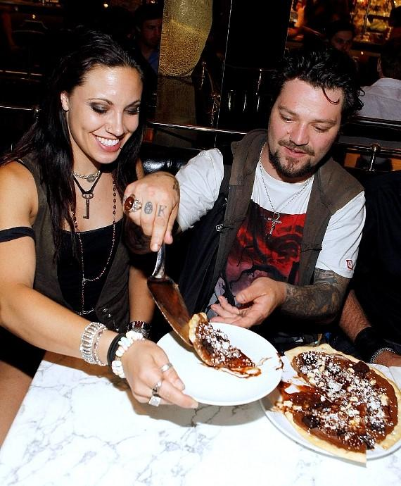 Bam Margera and Nikki B diving into the chocolate pizza