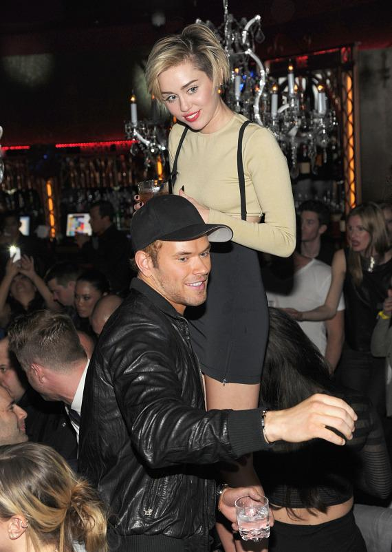 Miley Cyrus with Kellan Lutz at Beacher's Madhouse