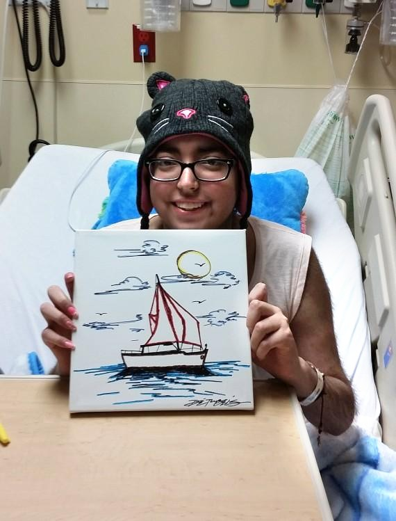 Becky and her artwork in the hospital