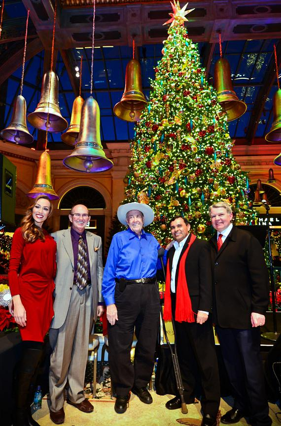 Host of M life TV, Didiayer Snyder; Bellagio Poker Tournament Director, Jack McClelland; American Poker Player, Doyle Brunson; Executive Director of Horticulture, Andres Garcia; and Bellagio President & COO, Randy Morton, pose after lighting the 42-foot tall holiday tree at Bellagio's Conservatory and Botanical Gardens December 6.