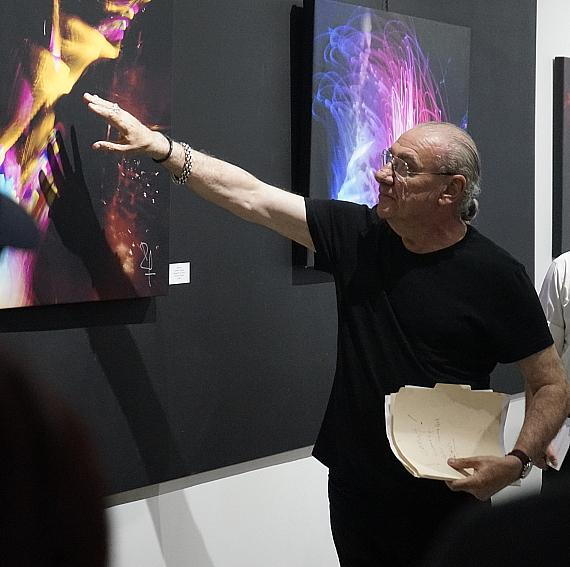 Bill Ward with artwork at The Gallery of Music & Art in Las Vegas