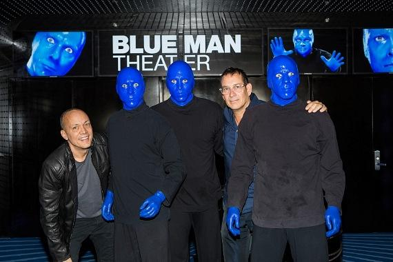 Blue Man Group poses with founders Chris Wink and Phil Stanton after skydive stunt