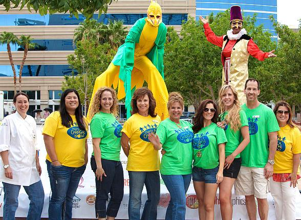 Create a Change Now board members posed with stilt walkers from Stilt Walk Entertainment.