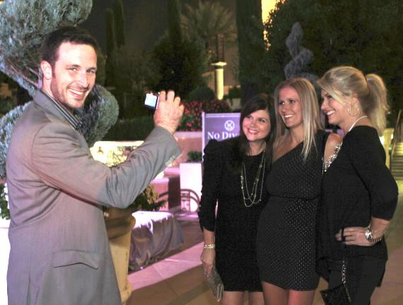Brady taking photo of Tiffani Thiessen and pals
