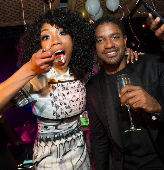 Brandy and fiance Ryan Press celebrate with cake at LAVO