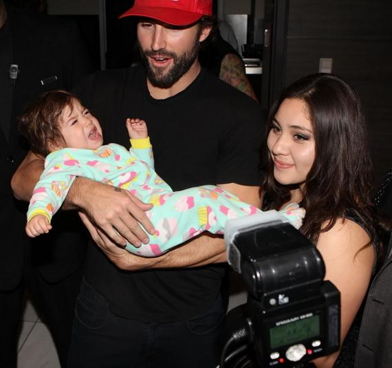 Brody Jenner stops to pose with an infant fan while walking to Ghostbar inside Palms Casino Resort