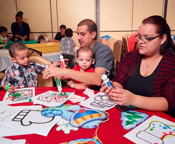 Kids drawing at Annual Easter Seals Nevada Holiday Party at Texas Station
