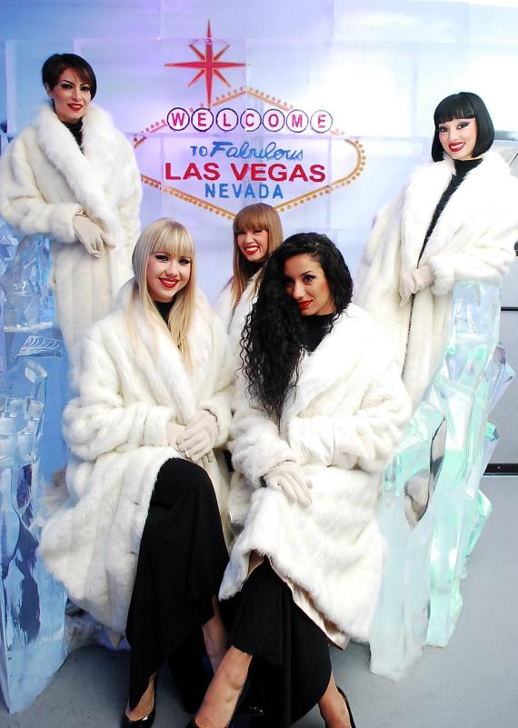 "Crazy Horse Paris ladies next to the ""Welcome to Las Vegas"" sign at Minus5 Ice Bar"