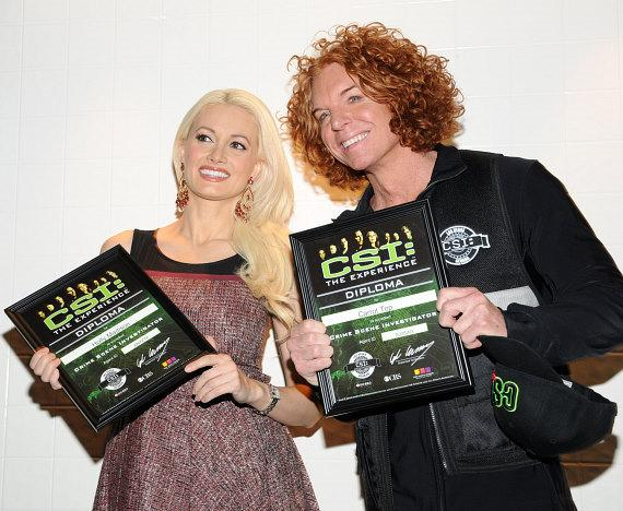 Holly Madison and Carrot Top receive their diplomas from CSI: The Experience at MGM Grand
