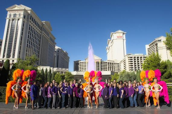 Caesars Employees pose at purple fountains
