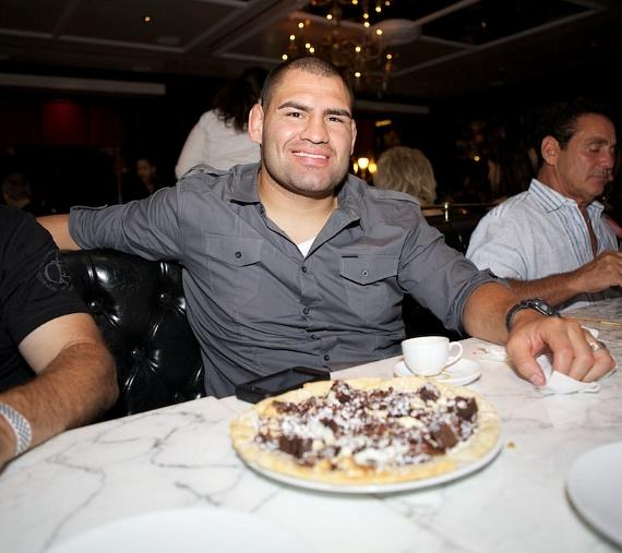 "Cain Velasquez with a decadent ""Chocolate, Chocolate, Chocolate"" sweet dessert pizza at Sugar Factory American Brasserie"