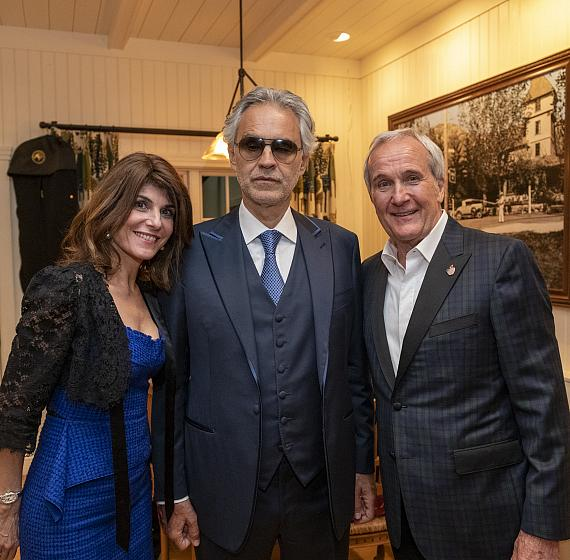 Camille Ruvo, Andrea Bocelli, Larry Ruvo pose in the historic Shakespeare Ranch