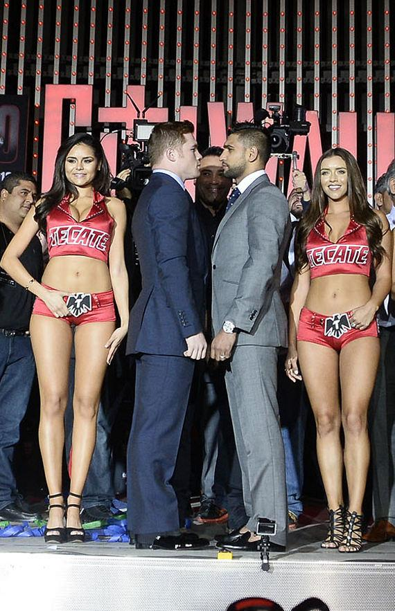 Canelo Alvarez and Amir Khan with ring girls at press conference