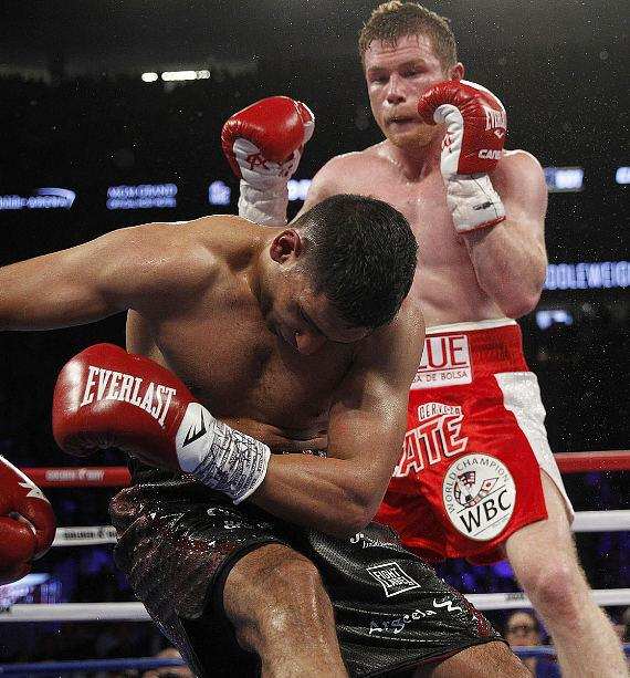 "Canelo Alvarez Knocks Out Amir ""King"" Khan in Sixth Round to Retain The WBC, Ring Magazine and Lineal Middleweight World Championship Titles"