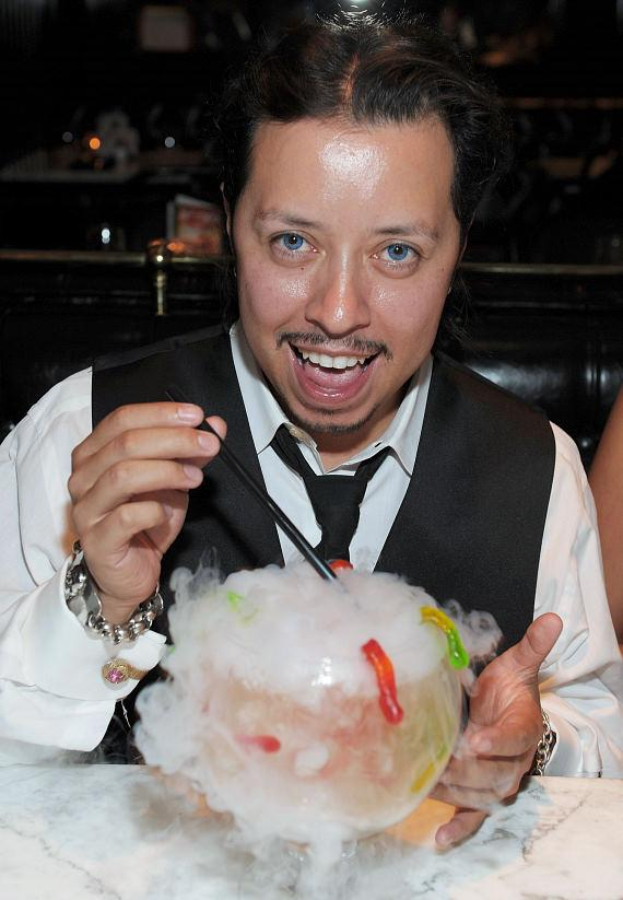 rlos Ramirez sipping a White Gummi cocktail at Sugar Factory American Brasserie in Las Vegas