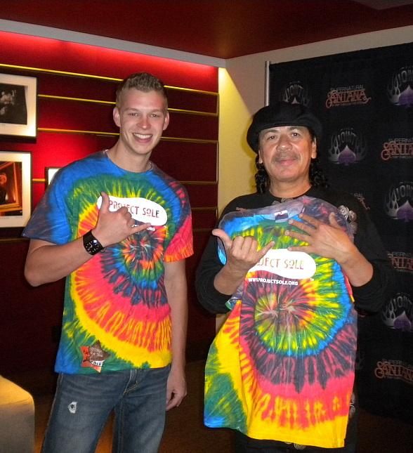 Carlos Santana with Co-founder of Project Sole Jaron Wilson