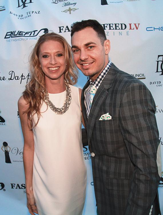 Catherine Treu of FashionFeedLV posing with Dapper Factory owner Derek Smoot