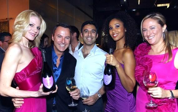 Celebrated interior designer and event planner Colin Cowie with guests at Mandarin Oriental, Las Vegas