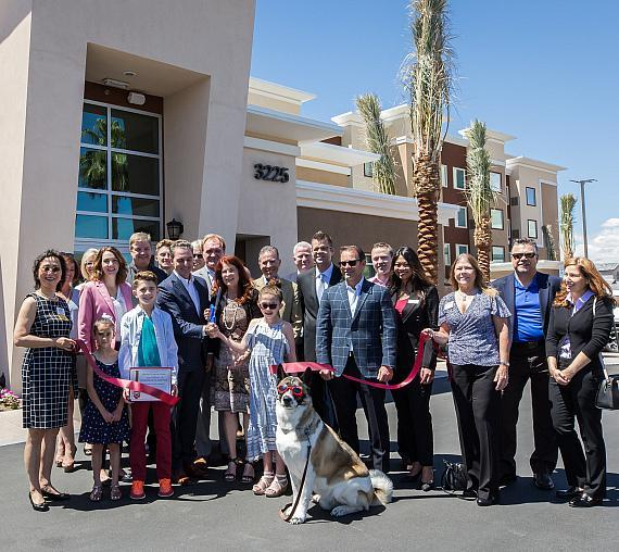 Ceremonial ribbon cutting at the new Residence Inn by Marriott with Mayor March, Nigro Family and Riko the Akita