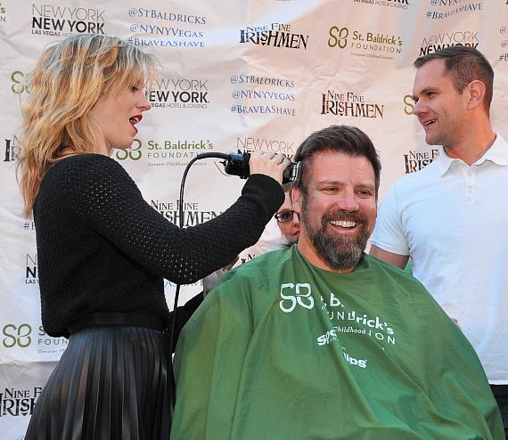 Charlie Starling of ABSINTHE at Caesars Palace shaves John M. McManus' head