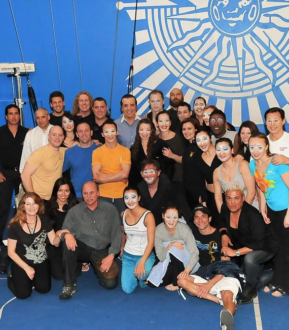 """Chazz Palminteri (center) visits with the cast of """"O"""" by Cirque du Soleil backstage"""