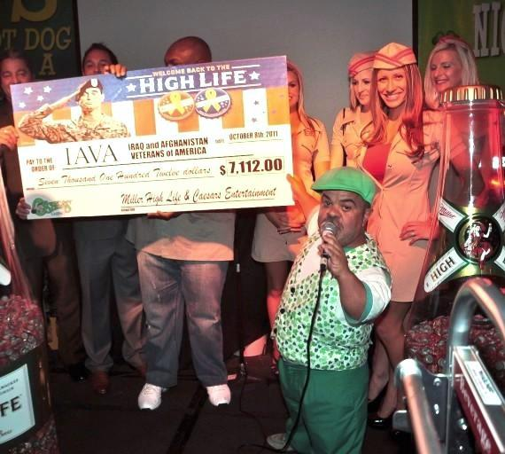 Brian Thomas, the Miller High Life girls, Wendell Middlebrooks and Caesars Entertainment executives present the check to the IAVA
