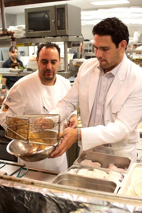 Mark Sanchez dishes up rock shrimp with Executive Chef Barry S. Dakake at N9NE Steakhouse