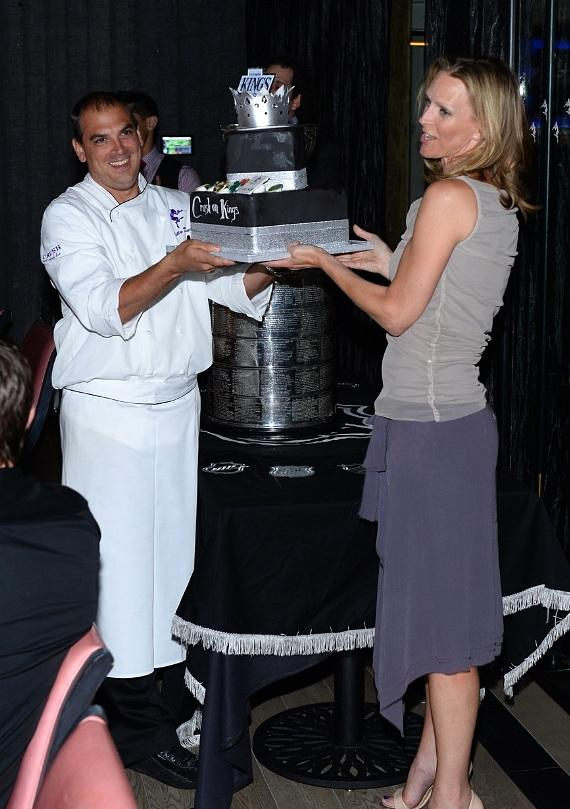 Chef Billy DeMarco and Jenna Morton present the cake